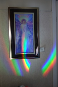 Archangel Raphael painting with rainbow